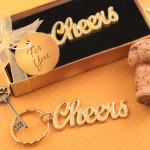 METAL CHEERS THEMED KEYCHAIN WITH A GOLD FINISH